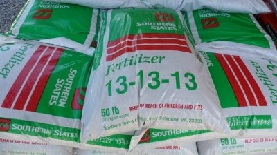 Green and white plastic bags. Cherokee Fertilizer 13-13-13
